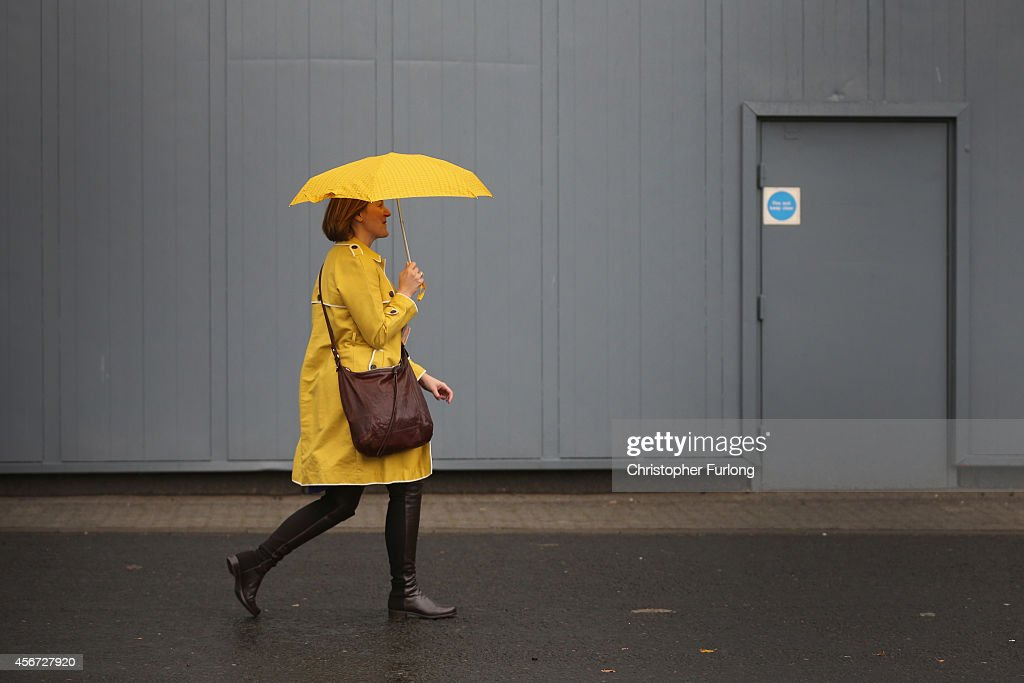 A delegate arrives in inclement weather at the Liberal Democrat Autumn conference at the SECC on October 6, 2014 in Glasgow, Scotland. Business Secretary Vince Cable will address delegates, and is expected to outline that immigration benefits the British economy and strengthens 'civic society'.