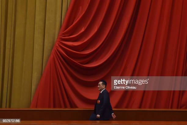 A delegate attends the 5th plenary session of the first session of the 13th National People's Congress on March 17 2018 in Beijing China