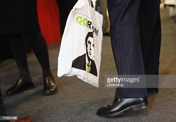 A delegate carries a canvas bag printed with an image of British Prime Minister Gordon Brown at the annual Labour Party Conference in Bournemouth in...