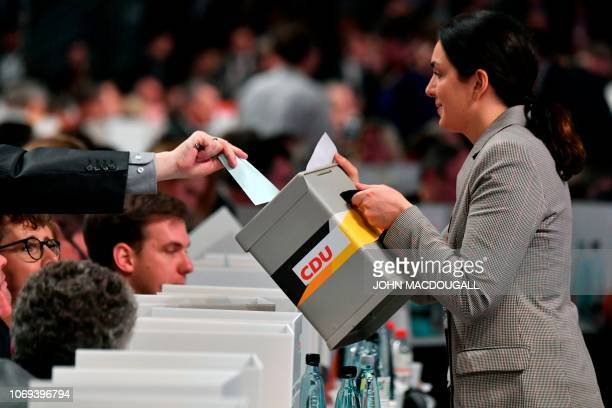 A delegate casts a vote to determine German chancellor's successor during a congress of Germany's conservative Christian Democratic Union party on...