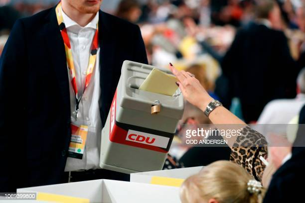 A delegate casts her vote to determine German chancellor's successor during a congress of Germany's conservative Christian Democratic Union party on...