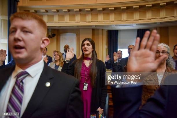 Delegate Danica Roem and other delegates are sworn in on the floor of the House of Delegates on Roem's first day in office at the Virginia State...