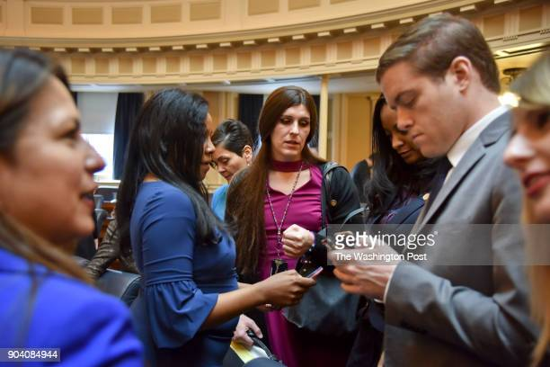 Delegate Danica Roem C chats with fellow lawmaker that include Charniele Herring 2nd from L Hala Ayala 3rd from L and Jennifer Carroll Foy 3rd from R...