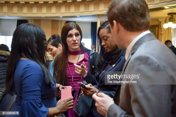 Delegate Danica Roem C chats with fellow lawmaker that include Charniele Herring L Hala Ayala 2nd from L and Jennifer Carroll Foy 2nd from R on her...
