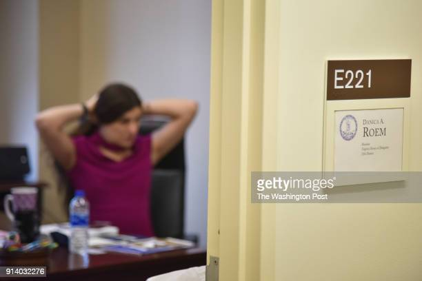 Delegate Danica Roem gathers herself shortly after arriving at her office on her first day at the Virginia General Assembly Building on Wednesday...