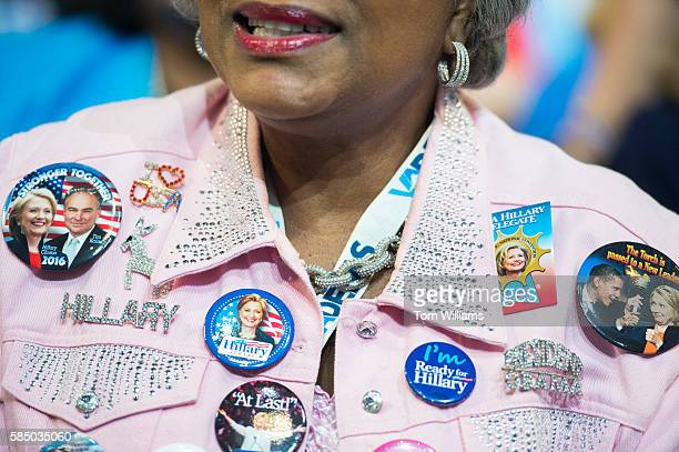 A delegate displays buttons on the floor of the Wells Fargo Center in Philadelphia Pa on the final night of the Democratic National Convention July...