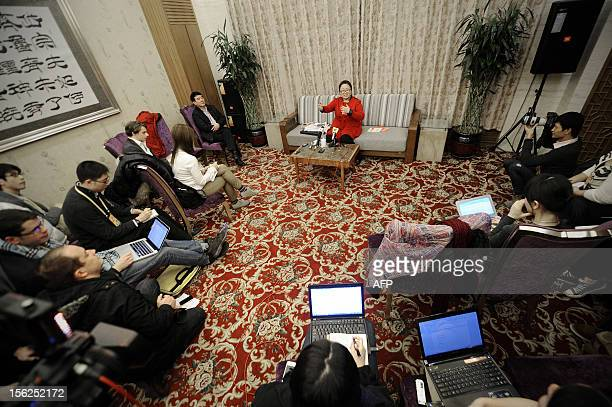 Delegate from Guangdong province, Yan Wenjing answers questions from the media at a collective interview during the 18th National Congress of the...