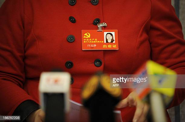 Delegate from Guangdong province,Yan Wenjing answers the media at a collective interview during the 18th National Congress of the Communist Party of...