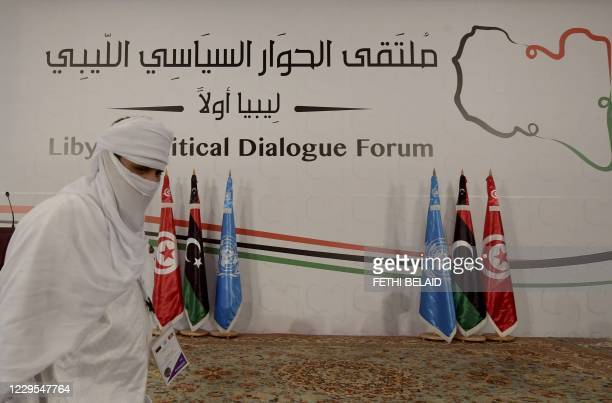 Delegate from Libya takes part in the Libyan Political Dialogue Forum hosted in Gammarth on the outskirts of Tunisia's capital, on November 9, 2020....