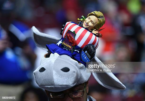 A delegate from Louisiana wears a Donkey hat with a Hillary Clinton doll atop on Day 1 of the 2016 Democratic National Convention at the Wells Fargo...