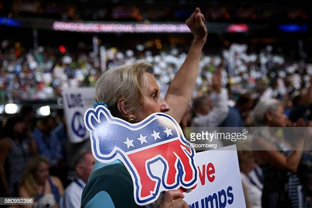 A delegate holds a Democratic party donkey sign during the Democratic National Convention in Philadelphia Pennsylvania US on Monday July 25 2016 The...