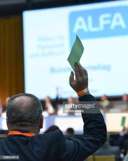 A delegate holds a voting card at the Allianz fuer Fortschritt und Aufbruch party conference in Ludwigshafen Germany 27 February 2016 PHOTO UWE...