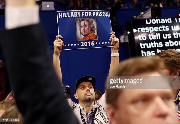 A delegate holds up a sign that reads Hillary For Prison on the third day of the Republican National Convention on July 20 2016 at the Quicken Loans...