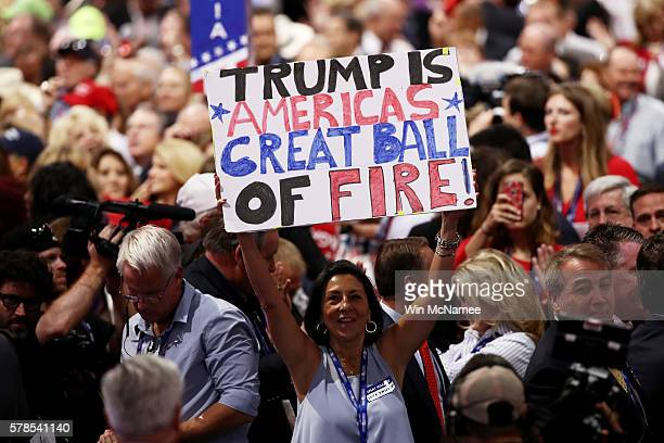 A delegate holds up a sign that reads 'Trump is Americas Great Ball of Fire' during the fourth day of the Republican National Convention on July 21...