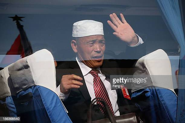 Delegate leaves the Tiananmen Square after the closing session of the 18th National Congress of the Communist Party of China on November 14, 2012 in...