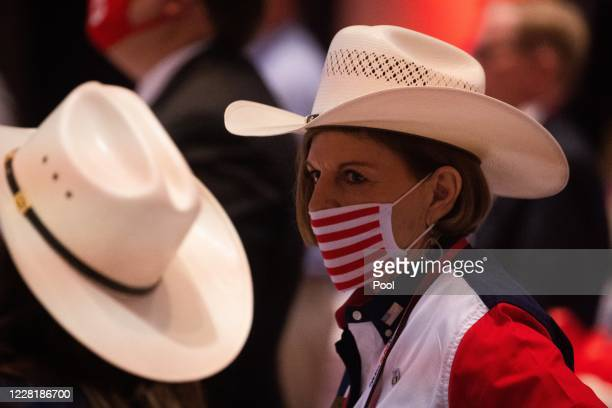 Delegate listens as U.S. President Donald Trump speaks on the first day of the Republican National Convention at the Charlotte Convention Center on...