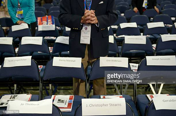 A delegate prays at the Tampa Bay Times Forum in Tampa Florida on August 28 2012 during an invocation at the Republican National Convention The 2012...