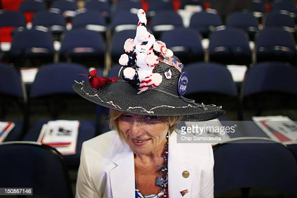 Delegate Ranae Lentz of Bellefontaine Ohio sits on the floor before the start of the second day of the Republican National Convention at the Tampa...
