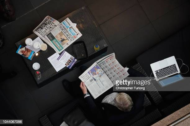 Delegate reads newspapers during day two of the annual Conservative Party Conference on October 1, 2018 in Birmingham, England. This year it is being...