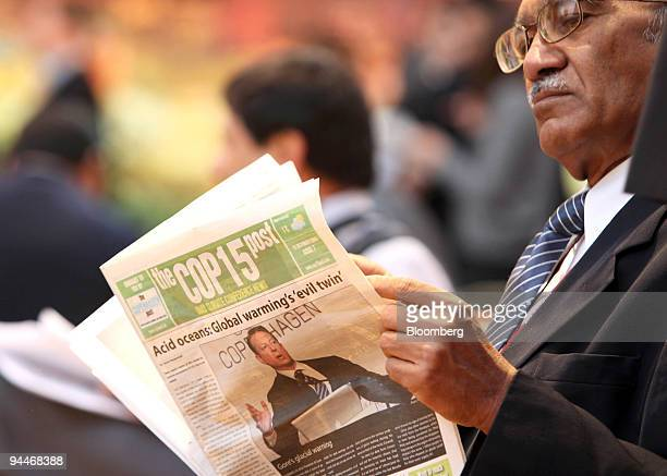 A delegate reads the daily COP15 newspaper at the COP15 United Nations Climate Change Conference at the Bella Centre in Copenhagen Denmark on Tuesday...