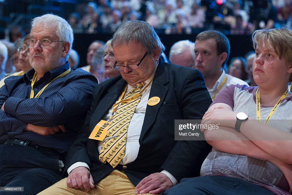 A delegate rests as he waits for the Liberal Democrats Tim Farron to speak on the second day of the Liberal Democrats annual conference on September 20, 2015 in Bournemouth, England. The Liberal Democrats are currently holding their annual conference using the hashtag #LibDemfightback in Bournemouth. The conference is the first since the party lost all but eight of its MPs in MayÕs UK general election, however after gaining 20,000 new members since May the party is expecting a record attendance at the event being held at the Bournemouth International Centre.