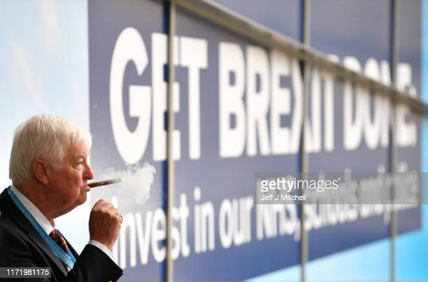 A delegate smokes a cigar as he arrives for the Conservative Party Conference on September 29 2019 in Manchester England Despite Parliament voting...