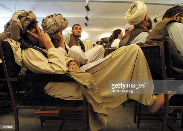 Delegate to the Loya Jirga grand assemble takes a nap as he waits for a session to convene June 18, 2002 in Kabul, Afghanistan. Newly elected...