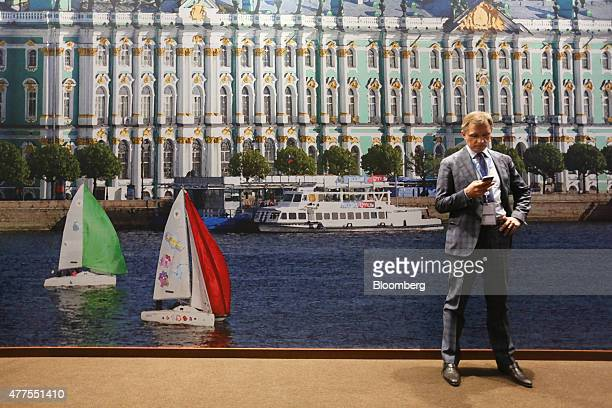 Delegate uses his mobile phone device in the entrance foyer of the Lenexpo center, on the opening day of the St. Petersburg International Economic...