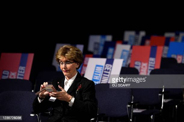 Delegate waits for the keynote speech of Britain's prime minister on the final day of the annual Conservative Party Conference at the Manchester...