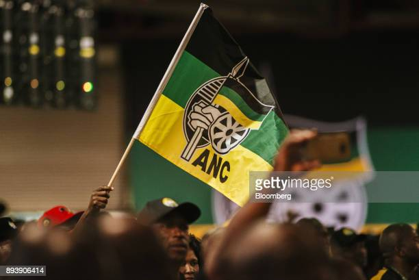 A delegate waves an ANC flag during a speech by Jacob Zuma South Africa's president not pictured at the 54th national conference of the African...