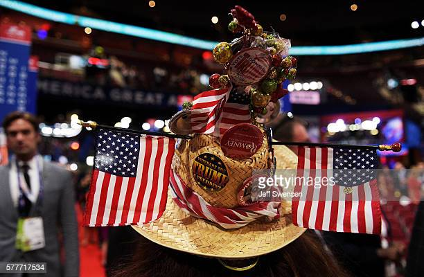 A delegate wears a decorated hat with during the second day of the Republican National Convention on July 19 2016 at the Quicken Loans Arena in...