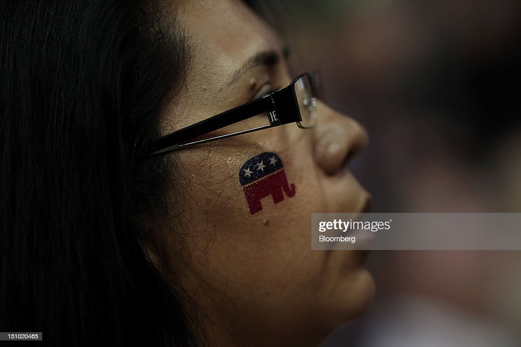 A delegate wears an elephant mascot temporary tattoo on her face at ...