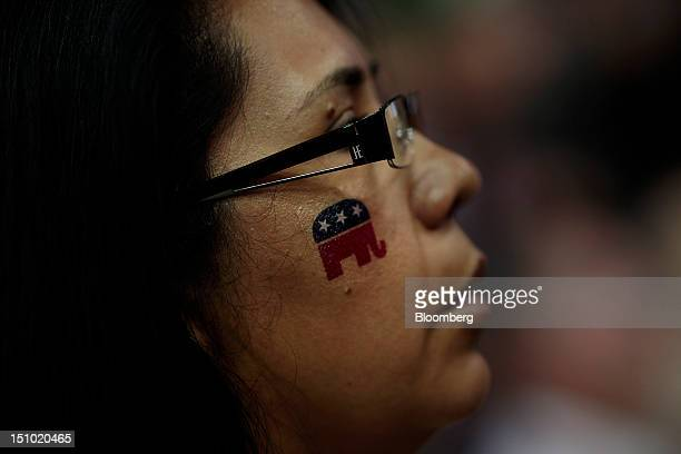 A delegate wears an elephant mascot temporary tattoo on her face at the Republican National Convention in Tampa Florida US on Thursday Aug 30 2012...