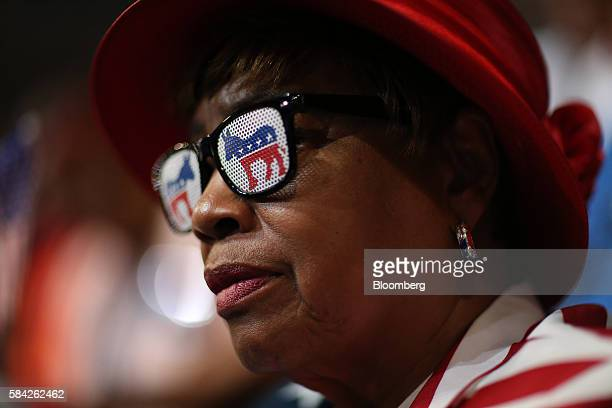 A delegate wears Democratic party donkey themed sunglasses during the Democratic National Convention in Philadelphia Pennsylvania US on Thursday July...