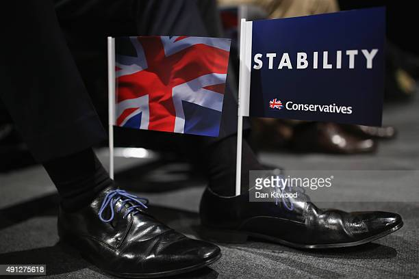 A delegate wears party flags in his shoes as British Defence Secretary Michael Fallon speaks during day one of the Conservative Party Conference on...