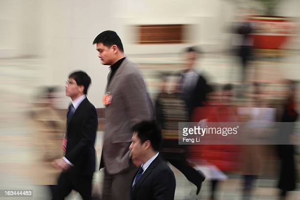 Delegate Yao Ming a former NBA basketball star arrives at the Great Hall of the People to attend a plenary session of the National People's Congress...