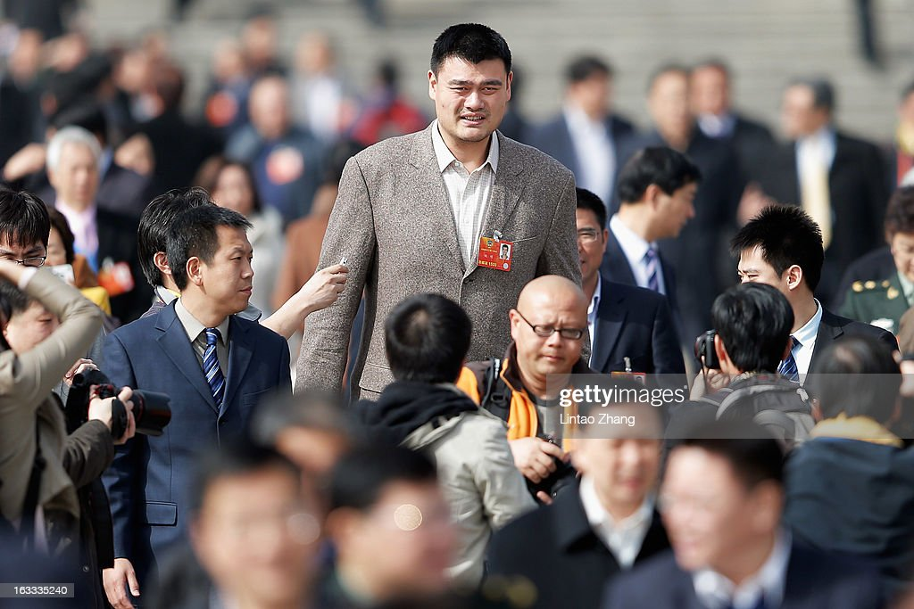 Delegate Yao Ming, former NBA basketball star, walks out the Great Hall of the People after a plenary session of the Chinese People's Political Consultative Conference at the Great Hall of the People on March 8, 2013 in Beijing, China. Clearing urban air pollution has become a big concern during the Chinese People's Political Consultative Conference. Over 2,000 members of the 12th National Committee of the Chinese People's Political Consultative, a political advisory body, are attending the annual session, during which they will discuss the development of China.