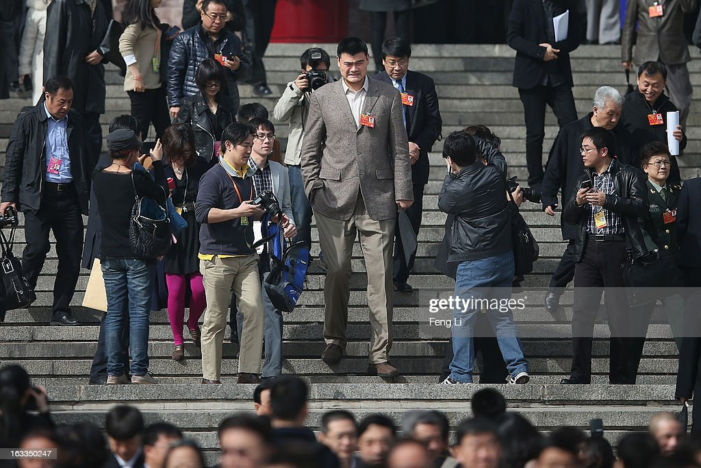 Delegate Yao Ming (Center), former NBA basketball star, walks out the Great Hall of the People after a plenary session of the Chinese People's Political Consultative Conference at the Great Hall of the People on March 8, 2013 in Beijing, China. Clearing urban air pollution has become a big concern during the Chinese People's Political Consultative Conference. Over 2,000 members of the 12th National Committee of the Chinese People's Political Consultative, a political advisory body, are attending the annual session, during which they will discuss the development of China.