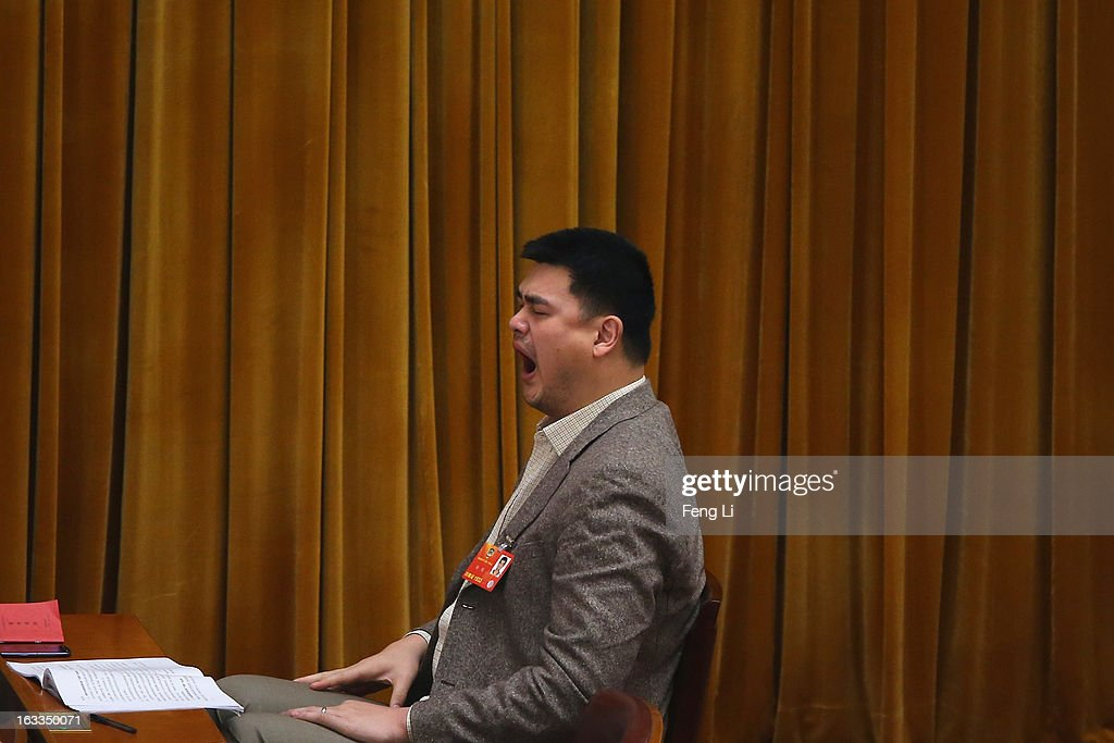 Delegate Yao Ming, former NBA basketball star, yawns as he attends a plenary session of the Chinese People's Political Consultative Conference at the Great Hall of the People on March 8, 2013 in Beijing, China. Clearing urban air pollution has become a big concern during the Chinese People's Political Consultative Conference. Over 2,000 members of the 12th National Committee of the Chinese People's Political Consultative, a political advisory body, are attending the annual session, during which they will discuss the development of China.