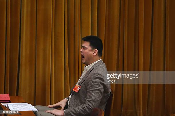 Delegate Yao Ming former NBA basketball star yawns as he attends a plenary session of the Chinese People's Political Consultative Conference at the...