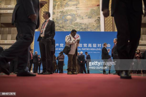 Delegates and party leaders gather to attend the closing ceremony of a meeting of world parties hosted by the Communist Party of China in Beijing on...