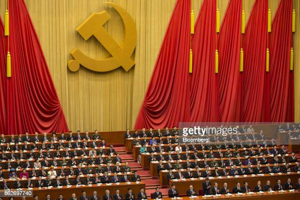 Delegates applaud during the opening of the 19th National Congress of the Communist Party of China at the Great Hall of the People in Beijing, China,...