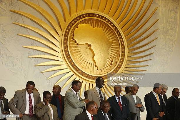Delegates arrange themselves for a group picture during a visit by the German president at the headquarters of the African Union on March 18 2013 in...