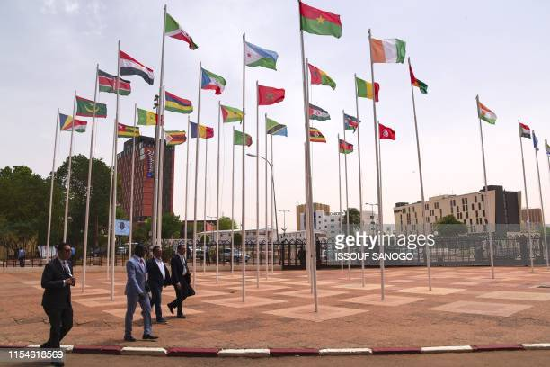 Delegates arrive at the Palais des Congres in Niamey on July 8 2019 for the closing ceremony of African Union summit Heads of state meet for an...
