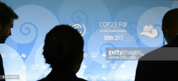 Delegates arrive for a family photo during the UN conference on climate change on November 15 2017 in Bonn western Germany / AFP PHOTO / Patrik...