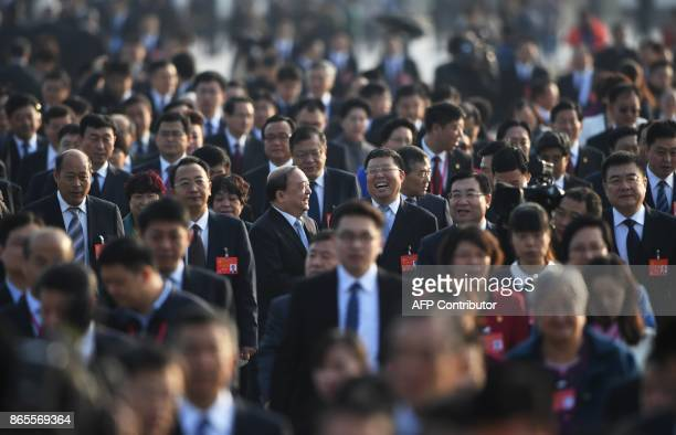 Delegates arrive outside the Great Hall of the People for the closing session of the 19th Communist Party Congress in Beijing on October 24, 2017. /...