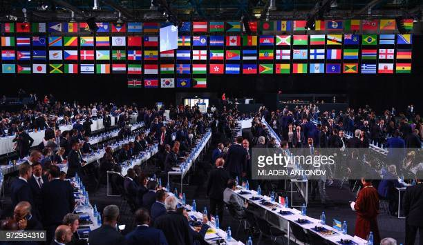 Delegates arrive to attend the 68th FIFA Congress at the Expocentre in Moscow on June 13 2018