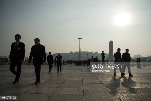 Delegates arrive to attend the seventh plenary session of the 13th National People's Congress at the Great Hall of the People on March 19 2018 in...