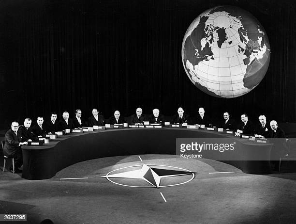 Delegates at the NATO conference at Paris From left Van Acker Dieffenbaker Gaillard Adenauer Hansen Karamanlis Jonasson Zoli Spaak Bech Hommel Luns...