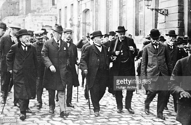 Delegates at the peace conference at Versailles including French Prime Minister Georges Clemenceau and British foreign secretary Arthur Balfour 1919...